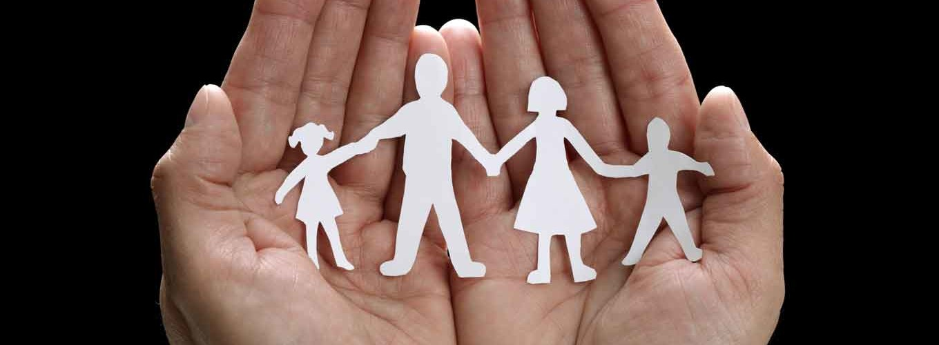 Hand with family cut out